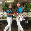 Briana Contreras — The Morning Journal <br> Jazmine Auble , 15, was the 2017 District 8 Holstein Queen and passed a new crown down to Cora Gunkelman, 15, the 2018 winner, during the Lorain County Fair on Aug. 21.