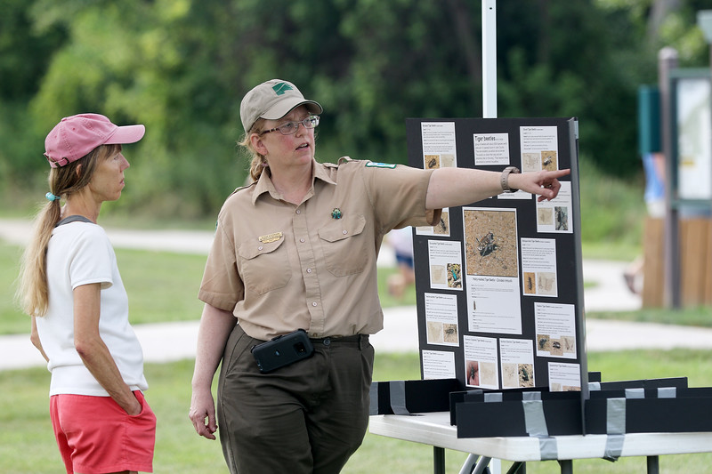 Jonathan Tressler - The News-Herald. Lake Metroparks Interpretive Naturalist Susan Wiedmann highlights some of the finer points of the inhabitants of Lake Erie Bluffs to a visitor Aug. 19 during the Lake Metroparks' Best of the Bluffs event at the park system's Lake Erie Bluffs facility in Perry Township.