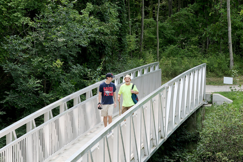 Jonathan Tressler - The News-Herald. Jake Bryda, left, and his dad, Ken, both from Willoughby Hills, share a laugh as they walk along the trail to the overlook at Lake Metroparks' Lake Erie Bluffs park during the venue's Best of the Bluffs event Aug. 19.