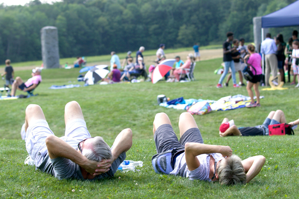 . Jonathan Tressler - The News-Herald <br> Visitors to the Geauga Park District�s Observatory Park assume a popular eclipse-viewing position Aug. 21.