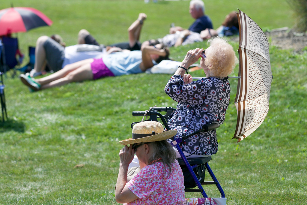 . Jonathan Tressler - The News-Herald <br>  A scene from the Eclipse Party at tyhe Geauga Park District�s Observatory Park in Montville Township Aug. 21.