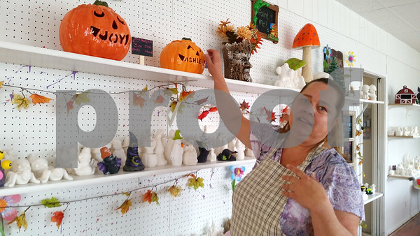 Christopher Heimerman – cheimerman@shawmedia.com<br /> Joy Blum, owner of Joy of Ceramics, 423 N. Main St., Sycamore, shows off the vast array of colors crafters can use to paint ceramic art in her shop.