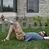 Katrina J.E. Milton - kmilton@shawmedia.com<br /> Justin Moore, a graduate student in the geology department at Northern Illinois University, relaxes on the grass next to Davis Hall as he observes the partial solar eclipse on Monday, Aug. 21.