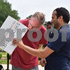 Katrina J.E. Milton - kmilton@shawmedia.com<br /> Northern Illinois University physics professor Michel van Veenendaal (left) and physics graduate student Bisham Poudel use a shadow box to observe the partial solar eclipse on Monday, Aug. 21. Van Veenendaal said he traveled to Germany to see a solar eclipse when he was younger, but the sky was too cloudy to observe anything.