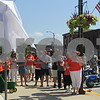 """Family and friends wait for unveiling of """"Roger Watson Way"""" during the Cruisin' to Genoa Car Show on Saturday in Genoa.  Aimee Barrows for Shaw Media"""