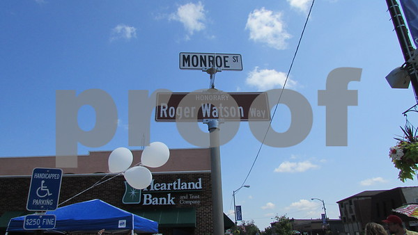 "Aimee Barrows for Shaw Media  ""Roger Watson Way"" is dedicated on the corner of Main and Monroe streets during the Cruisin' to Genoa Car Show on Saturday in Genoa."