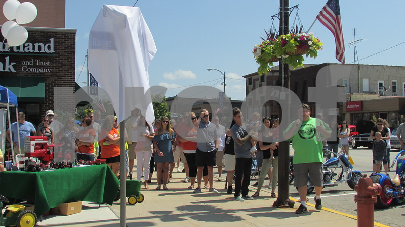 """Mayor Mark Vicary speaks at the dedication of """"Roger Watson Way"""" during the Cruisin' to Genoa Car Show on Saturday in Genoa.  Aimee Barrows for Shaw Media"""