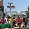 """Family and friends gather around the newly dedicated """"Roger Watson Way"""" during the Cruisin' to Genoa Car Show on Saturday in Genoa.  Aimee Barrows for Shaw Media"""