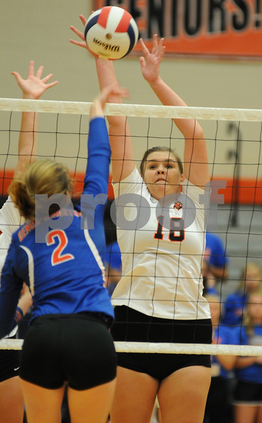 DeKalb's Kayli Hilliard goes up to block a spike by Lily McPherson of Genoa-Kingston on Tuesday, August 21 in DeKalb.  Steve Bittinger - For Shaw Media