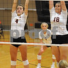 Isabella Finch (4) and Kayli Hilliard (18) go up to block a shot in a match against Genoa-Kingston on Tuesday..<br /> Steve Bittinger - For Shaw Media