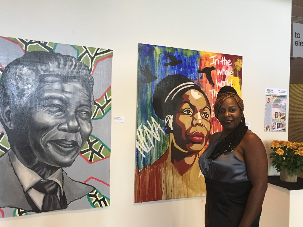 . Kevin Martin - The Morning Journal <br> Sharon Pye-Brown, of Lorain, is a featured artist and daughter of James F. Pye. Here she poses with artwork at LCCC�s Stocker Arts Center.
