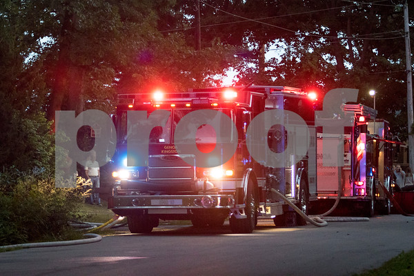 Sam Buckner for Shaw Media.<br /> Genoa-Kingston Fire engines are parked on Oak Drive in Genoa after a fire started on Thursday August 24, 2017.