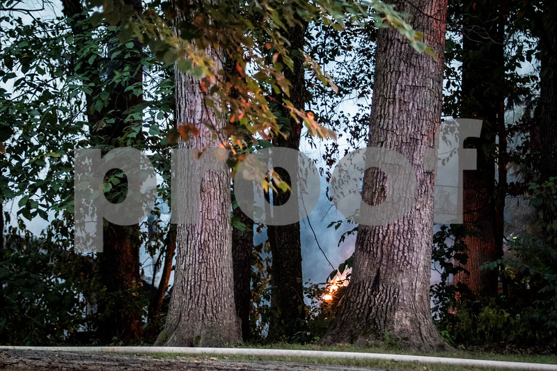 Sam Buckner for Shaw Media.<br /> A small flame is still lit after a fire on Oak Drive in Genoa was under control on Thursday August 24, 2017.