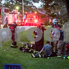 Sam Buckner for Shaw Media.<br /> Fire Fighters rest across the street from 29790 Oak Drive in Genoa where a fire was started on Thursday August 24, 2017.