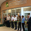 Carol Harper — The Morning Journal <br> Cutting the ribbon Aug. 24, 2016, are Amherst School Board President Rex Engle and Duane Neidert, president of Amherst Schools Educational Foundation, which provided a grant of $200,000 toward a project totaling $700,000 to renovate a former media center at Marion L. Steel High School, 450 Washington St., Amherst.