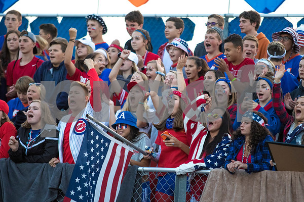 Sam Buckner for Shaw Media.<br /> Genoa-Kingston student section is dressed up for the red white and blue themed night on Friday August 25, 2017.