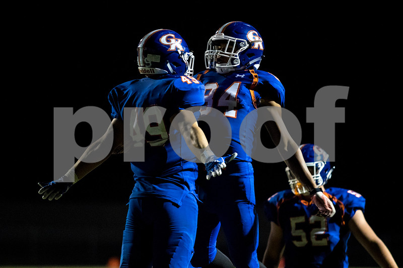 Sam Buckner for Shaw Media.<br /> Jayson Szczepanski chest bumbs Jackson Ebel after scoring a touchdown on Friday August 25, 2017 against Rockford Lutheran.