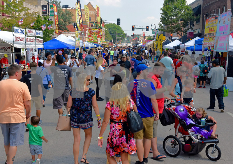 People fill Lincoln Highway in downtown DeKalb on Saturday for Corn Fest. <br /> Steve Bittinger - For Shaw Media