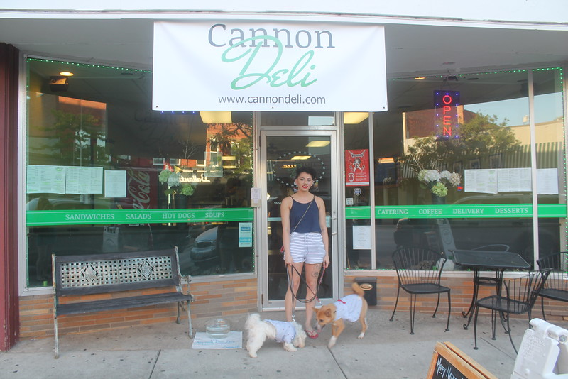 Harley Marsh — The News Herald <br> Jodie Di Donato, of Cleveland Heights, lets her dogs Yeezus and Margo drink from the complementary water in front of Cannon Deli for National Dog Day on Aug. 26, 2016. She tried to take her dogs to the Pig & Whiskey event but was told there are no dogs allowed.