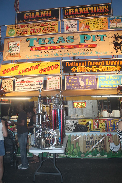 . Harley Marsh � The News Herald <br> Texas Pit displays their trophies from previous events during the Pig & Whiskey event in downtown Willoughby Aug. 26, 2016.