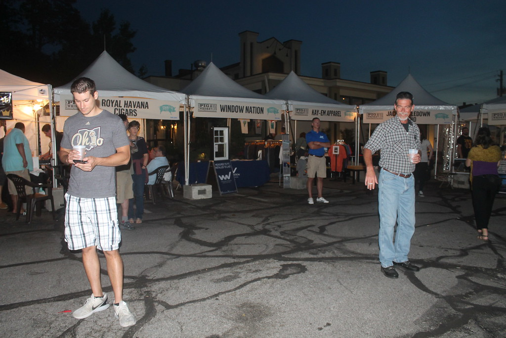 . Harley Marsh � The News Herald <br> Patrons enjoy whiskey during the Pig & Whiskey event in downtown Willoughby Aug. 26, 2016.