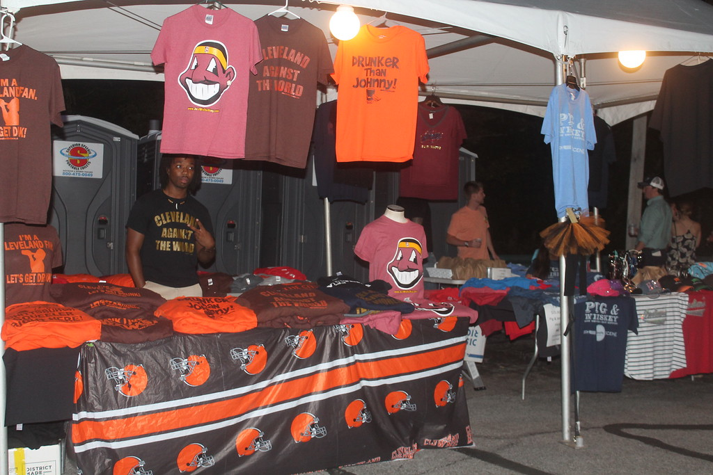 . Harley Marsh � The News Herald <br> A vendor sells Cleveland gear at the Pig & Whiskey event in downtown Willoughby on Aug. 26, 2016.