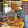 Drew Zimmerman – dzimmerman@shawmedia.com<br /> Barry Melton of the DeKalb Kiwanis Club butters ears of roasted corn during the 40th annual DeKalb Corn Fest, which kicked off on Friday.