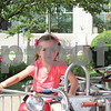Drew Zimmerman – dzimmerman@shawmedia.com<br /> Maycee Kidd, 5, of DeKalb rides on one of the rides at DeKalb's 40th annual Corn Fest, which kicked off on Friday.