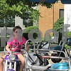Drew Zimmerman – dzimmerman@shawmedia.com<br /> Hailey Kidd, 8, of DeKalb rides on one of the rides at DeKalb's 40th annual Corn Fest, which kicked off on Friday.