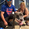 Richard Payerchin - The Morning Journal <br> Tyler and Mae Calvert of Elyria pose for a photo with Shark, a Lorain County Dog Kennel resident that they adopted in August and took home Aug. 26, 2017, at the kennel's first Dog Appreciation Day. The kennel had six dogs adopted and one claimed by its owner during the event, meant to connect families to new pets and raise awareness of the mission of the facility.