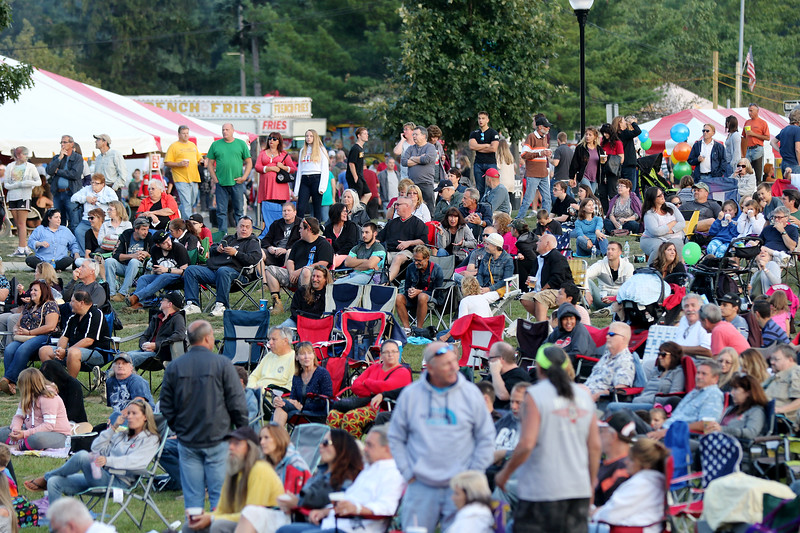 Jonathan Tressler — The News-Herald <br> The crowd at Mentor CityFest was thousands deep in front of the city's new amphitheater as Pink Floyd cover band Dark Side of the Moon prepared to play Aug. 26.