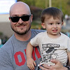 Jonathan Tressler — The News-Herald <br> Mentor native Nick Laccheo, who says his favorite band is Dark Side of the Moon, strikes a pose for a portrait with year-and-a-half-year-old son, Max, shortly before the band starts its set at Mentor CityFest Aug. 26. Laccheo and his wife - both Mentor natives - just moved back from Columbus Saturday and couldn't be happier it was the same day the band was playing at CityFest.