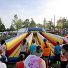 Jonathan Tressler — The News-Herald <br> Kids gear up for a go at the bungee run attraction at Mentor CityFest Aug. 26 at teh Mentor Civic Center.
