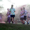 Jonathan Tressler — The News-Herald <br> Participants in the Color Dash fun run/walk during Mentor CityFest 2017 get pelted with colored powder Aug. 26.