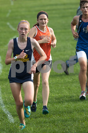 Sam Buckner for Shaw Media.<br /> Megan LeBlanc runs at the Sycamore Invitational on Tuesday August 29, 2017.