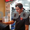 Drew Zimmerman – dzimmerman@shawmedia.com<br /> Mithilesh Gajjar, an employee at Marco's Pizza, places an order Tuesday afternoon. Marco's Pizza, located at 456 E. Lincoln Highway, opened its doors to the public on Aug. 21.