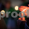 Sam Buckner for Shaw Media.<br /> A candle is lit at the vigil on Thursday August 31, 2017 at the corner of First and Lincoln Highway in Dekalb.