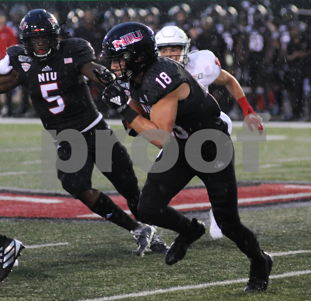 NIU receiver Cole Tucker heads up field in first half action on Saturday.  Steve Bittinger - For Shaw Media