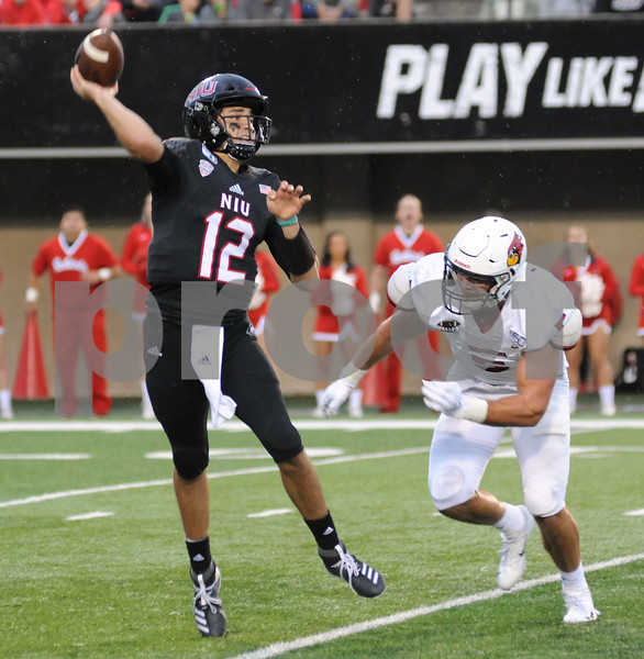 NIU quarterback Ross Bowers delivers a pass under pressure from Bryce Jefferson of ISU on Saturday in DeKalb.  Steve Bittinger - For Shaw Media