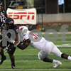 Huskie Marcus Jones fights off a tackle in first half action Saturday night against ISU.  Steve Bittinger - For Shaw Media