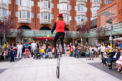 Street performer entertains shoppers in Ealing Broadway Shopping Centre,  Ealing, W5, London, United Kingdom