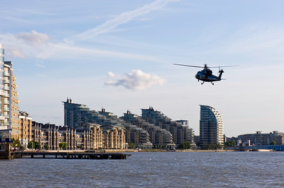 Helicopter taking off from London Heliport in Battersea, SW11, by Thames River, London, United KIngdom