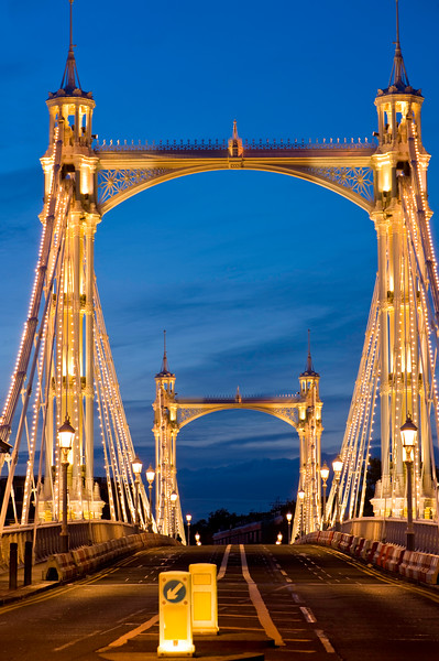 Albert Bridge illuminated in the evening, Thames River, London, United KIngdom