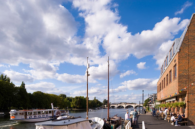 People relaxing by Thames River, Kingstone upon Thames, Surrey, United Kingdom