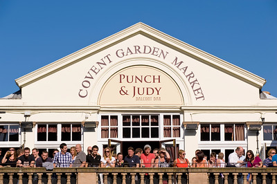 People enjoy warm summer day, Covent Garden, London, United Kingdom