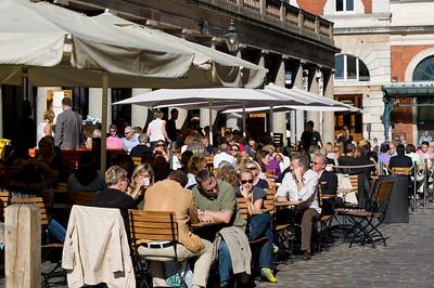 People enjoy warm summer day, Covent Garden, London, United Kingdom