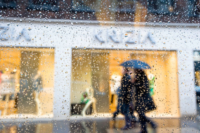 Shopping in the rain, Conduit Street, W1, London, United Kingdom