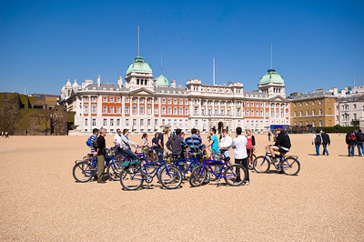 Tourists on bicycles visit Horse Guards Square, London, United Kingdom