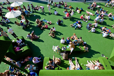 People enjoy hot summer day by Royal National Theatre, Southbank, London, United Kingdom