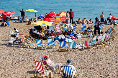 People relaxing on the pebled beach, Brighton, East Sussex, United Kingdom